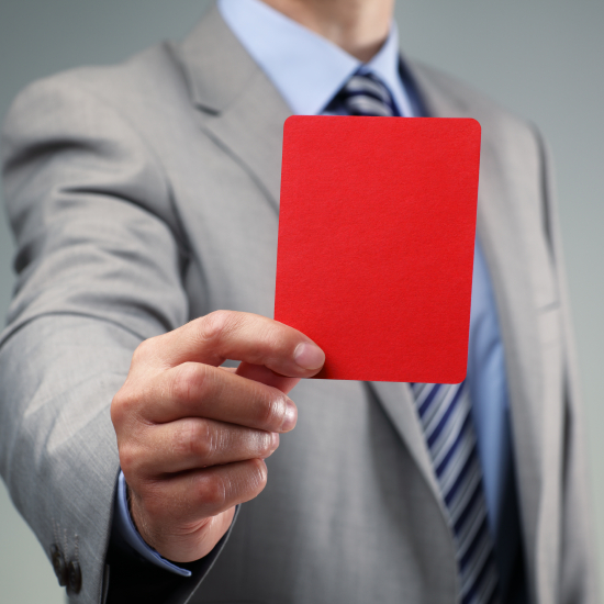 Smaller picture of a man with tie and suit holding a red card